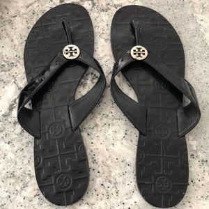 Tory Burch thong sandals.